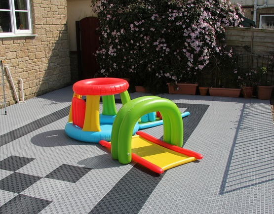 Playing area with interlocking rubber floor