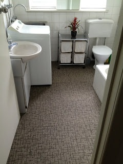 Dark-brown carpet for bathroom floor