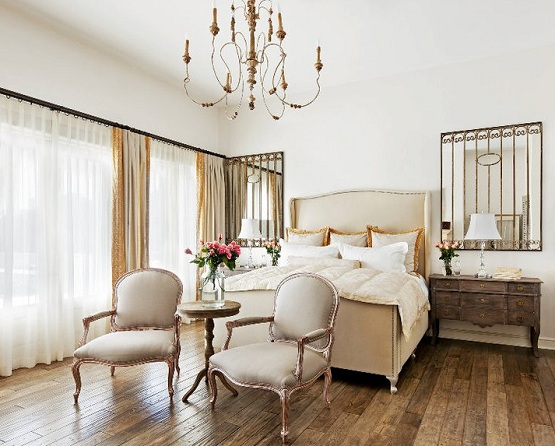 French bedroom design with recycled wood flooring