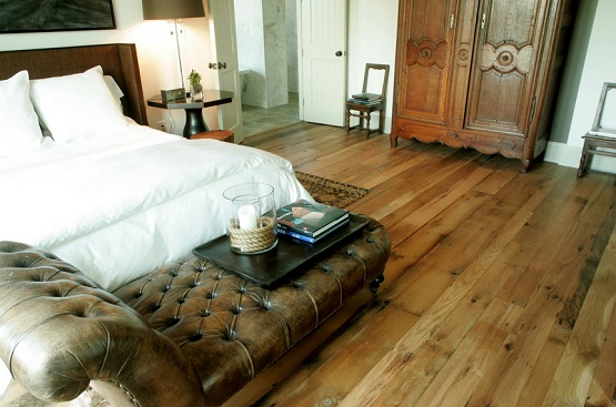 Rustic bedroom with recycled wood flooring