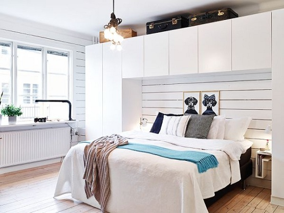 White Bedroom with recycled wood flooring design
