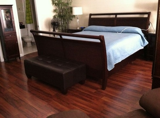 Bedroom with dark cherry laminate flooring