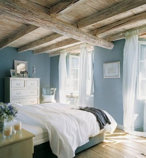 Blue bedroom with rustic hardwood floor