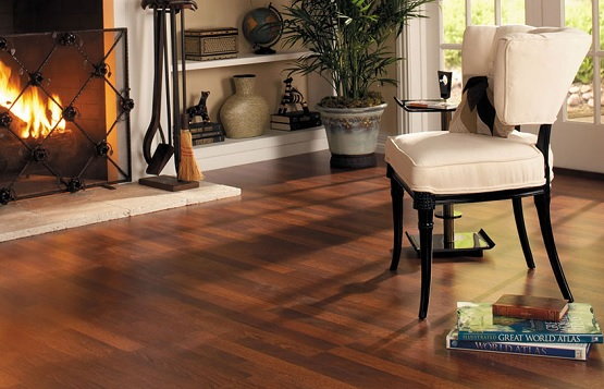 Dark cherry laminate flooring in fireplace room