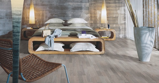 Grey oak laminate flooring in contemporary bedroom