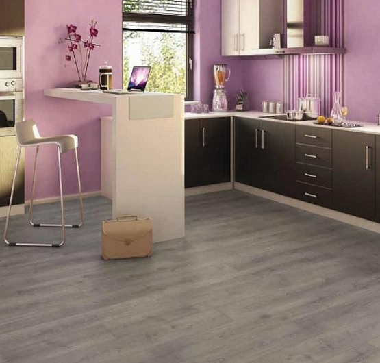 Pink kitchen with grey laminate flooring