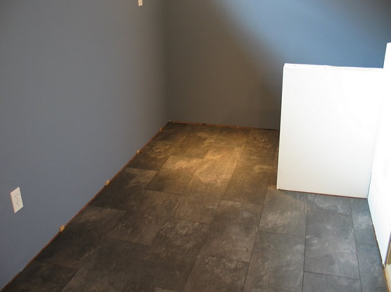 Slate laminate interlocking tile for basement