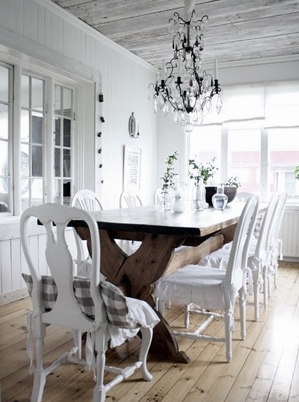 White dining room with rustic hardwood flooring