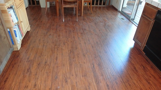 Dining room with hand scraped laminate flooring