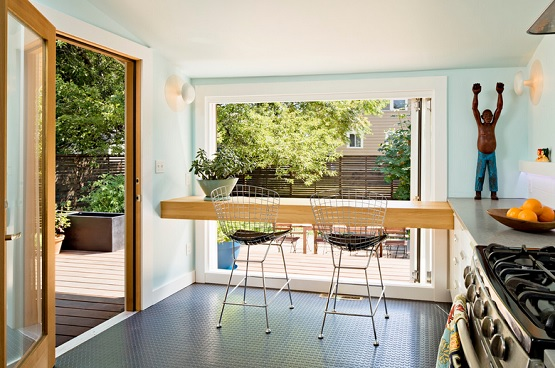 Kitchen and dining room with rubber flooring residential