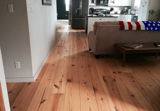 Kitchen with prefinished wide plank pine flooring