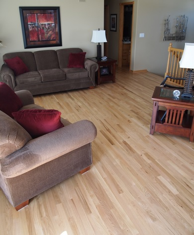 Living room with unfinished red oak flooring