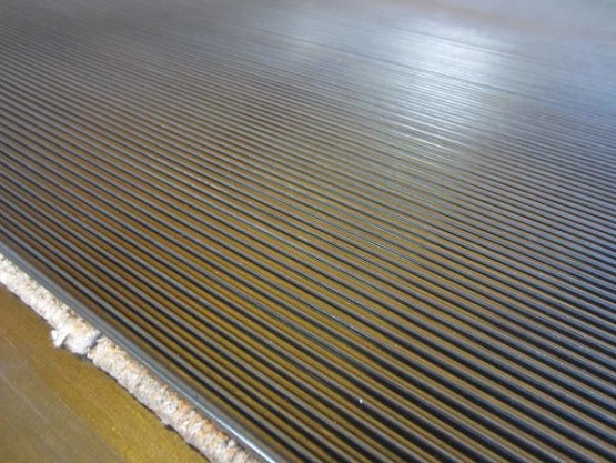 Ribbed black rolled rubber flooring