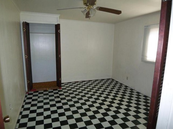 Bedroom renovations with black and white linoleum flooring