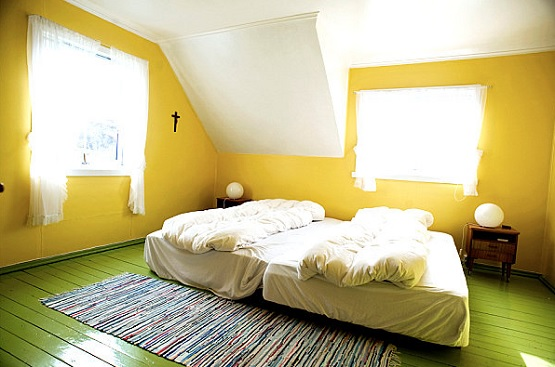 Bedroom with green wood floor paint
