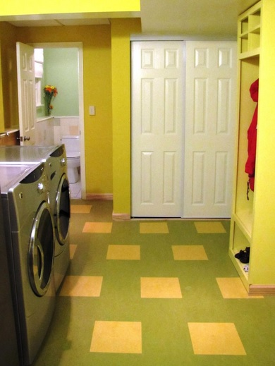 Painting linoleum floor in yellow laundry room