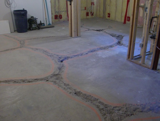 concrete floor you can use concrete repair compound or concrete patch