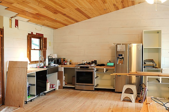 Simple kitchn with tongue and groove boards flooring