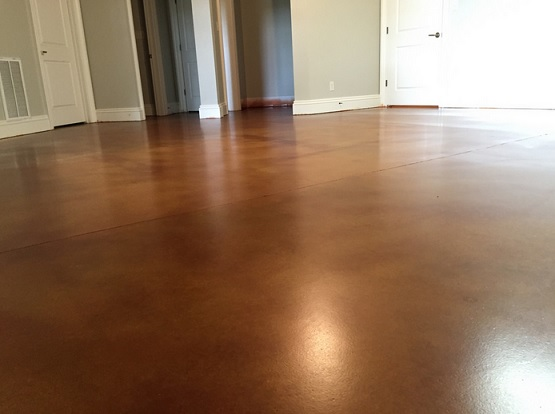Stained concrete basement floor with urethane sealers