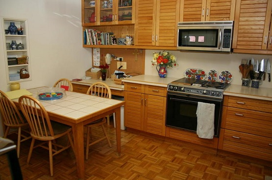 Vintage style kitchen with linoleum parquet wood floors