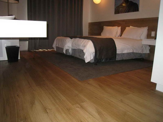 Adult bedroom with floating vinyl plank flooring