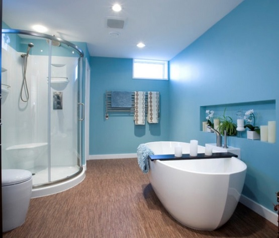 Bamboo flooring in bathroom with blue wall paint color