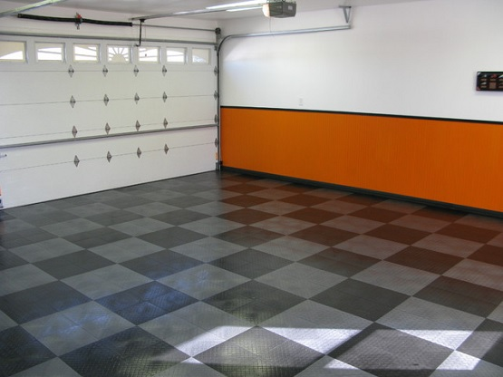 Contemporary garage with grey vinyl garage flooring