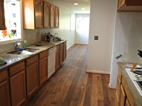 Kitchen with floating vinyl plank flooring