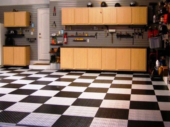 Rigid plastic tile garage floor covering