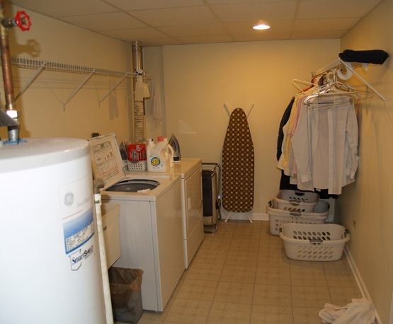 Small basement laundry room with ceramic tile flooring