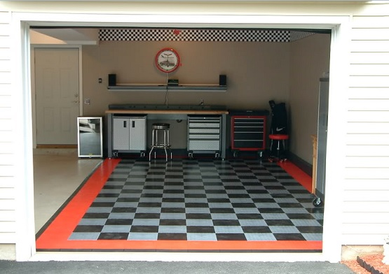 Small garage with checkered rubber garage floor tiles
