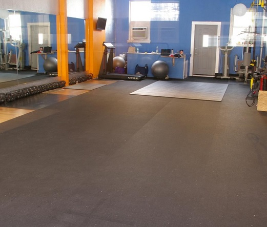 Plyometric type rubber roll home gym flooring over carpet