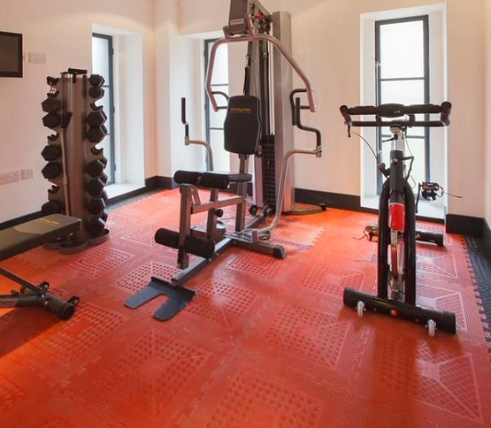 Red interlocking rubber tile for home gym flooring
