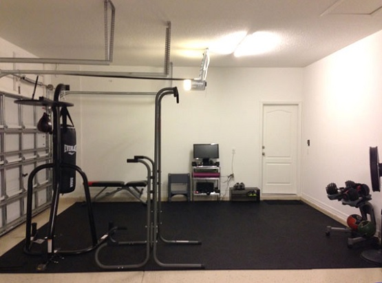 Rolled rubber home gym flooring over carpet