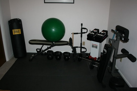 Simple small home gym with interlocking rubber flooring
