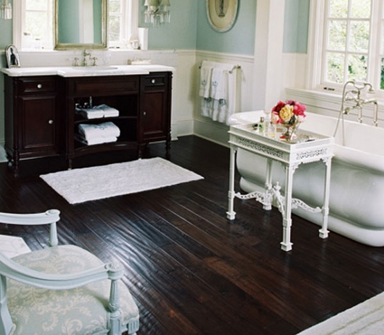Dark-colored hardwood flooring in bathroom