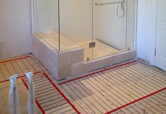 Radiant heated bathroom floors