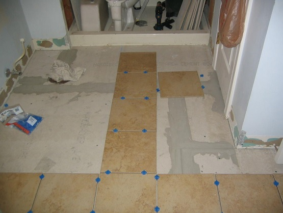 Retile bathroom floor on a budget flooring ideas floor for Cheap diy flooring ideas
