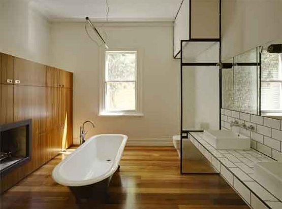 Synthetic natural wood look flooring option in bathroom