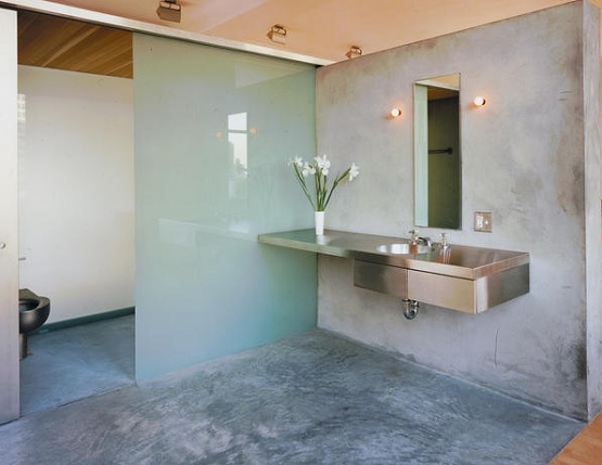 Bathroom with sliding shower and concrete bathroom floor