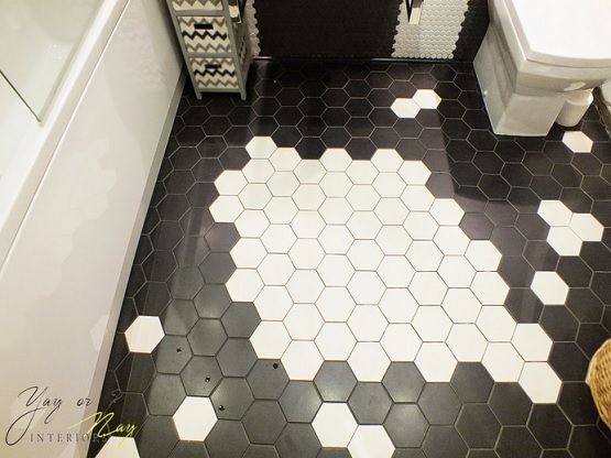 Black and white bathroom floor tile hexagonal design