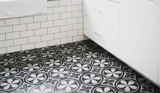Black and white kamboja flower bathroom floor tile motif