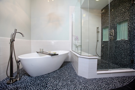 Black and white stone tile bathroom floor design