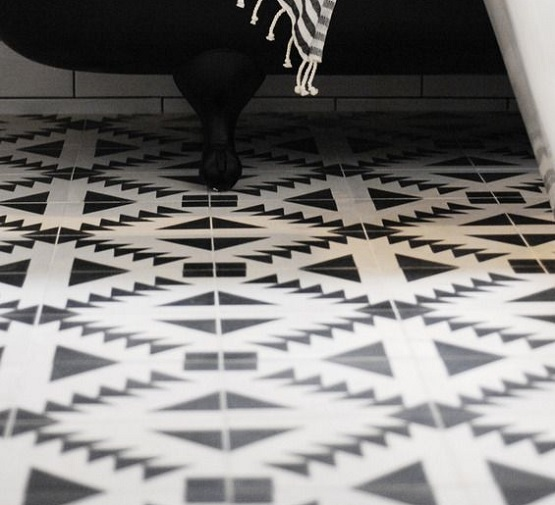 Elegant black and white bathroom floor tile design