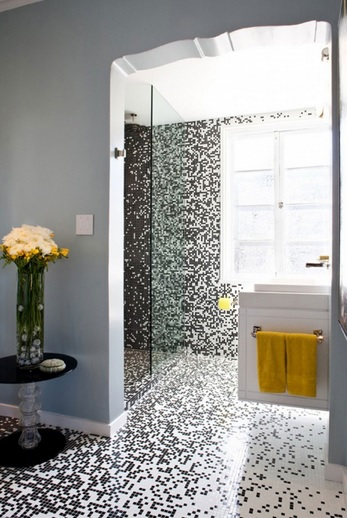 Modern small bathroom with black and white bathroom floor tile
