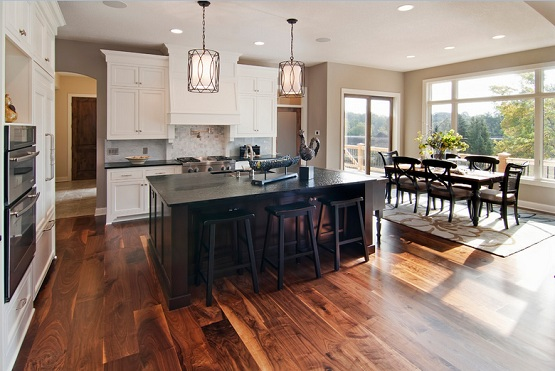 Brazilian Walnut Flooring In Kitchen With Black Kitchen Islands