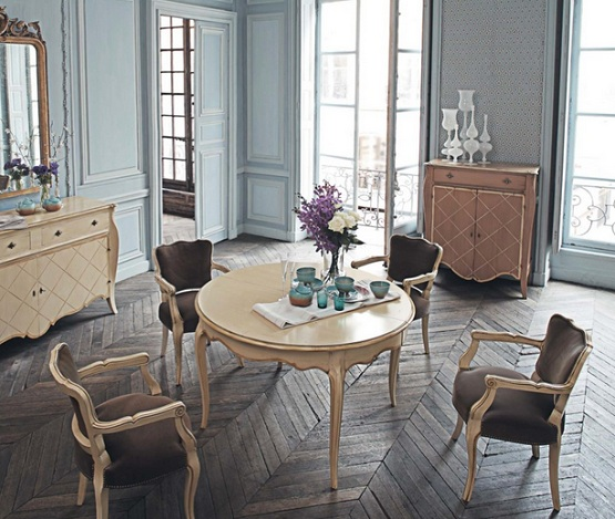 Herringbone pattern distressed wood flooring with classic furniture