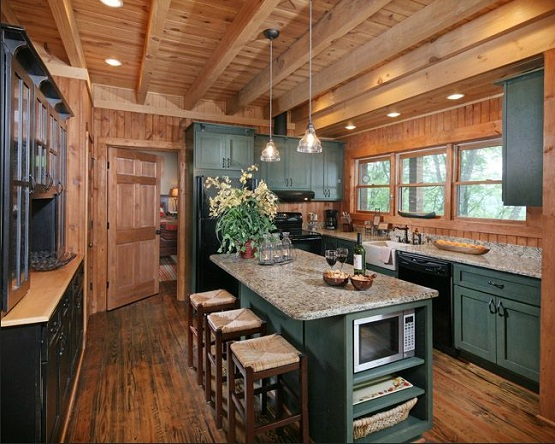 Kitchen with distressed wood flooring