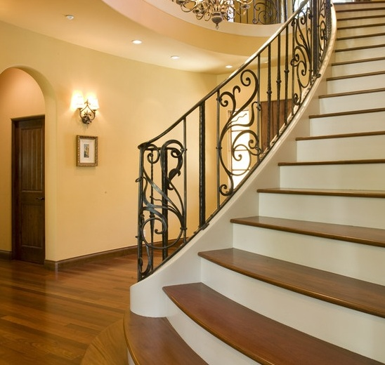 Mediterranean staircase with brazilian walnut