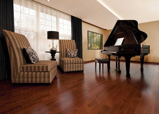 Piano room decor with red oak hardwood flooring